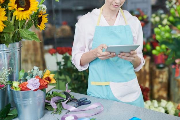 Florist using tablet in shop