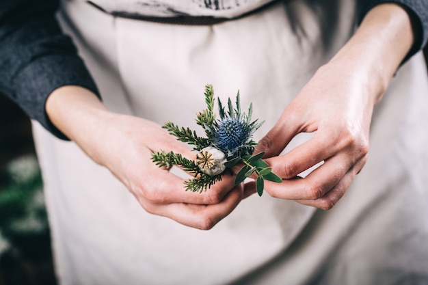 Florist with flower arrangement