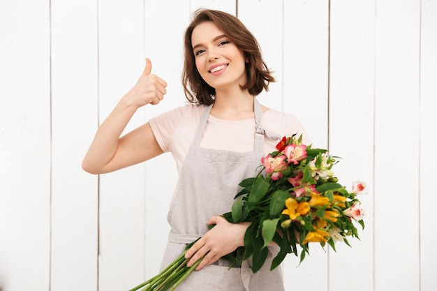 Florist woman standing with flowers