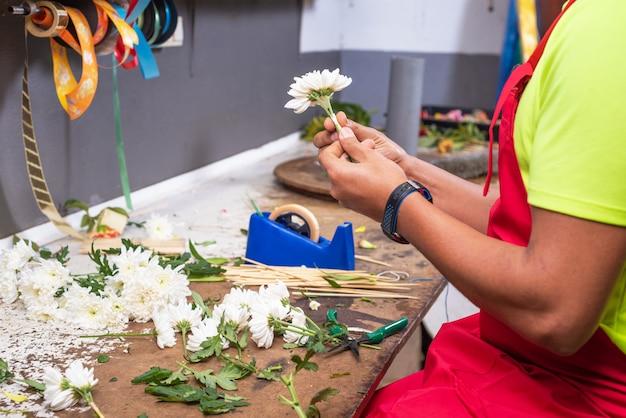 Florist at work. male florist creating beautiful bouquet at flower shop.