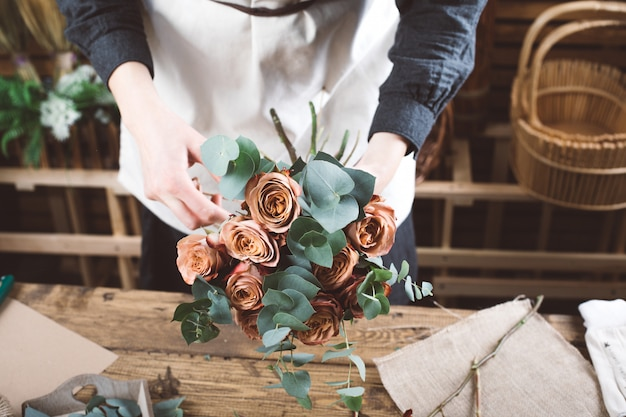 Florist working in modern flower shop