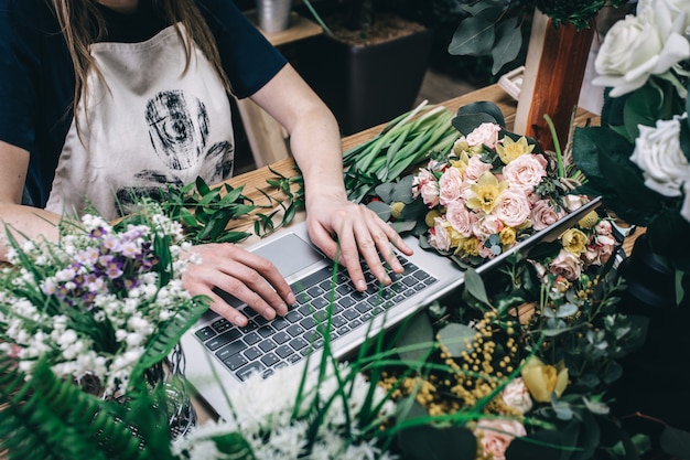 Florist working with laptop