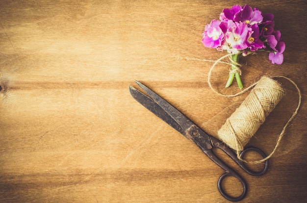 Floristic background. flowers, scissors and rope.