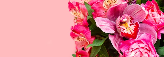 Flower arrangement, phalaenopsis orchid among flowers on a pink background, banner, holiday card, greeting card blank