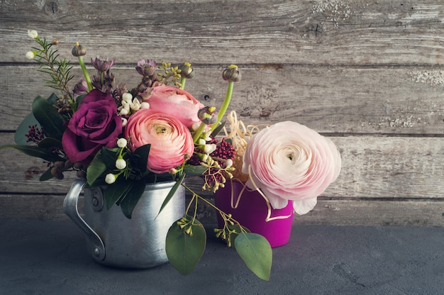 Flower arrangement of roses and ranunculus