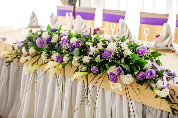 Flower arrangement on the table. purple and white flowers.