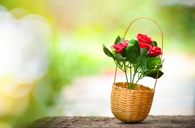 Flower basket bouquet in bamboo basket with summer nature