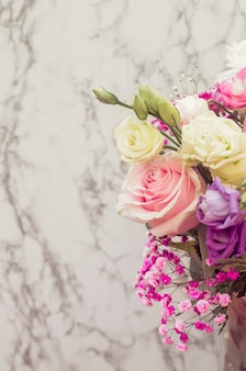 Flower bouquet against marble textured background