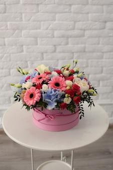 Flower bouquet in a box inside a store. women's day
