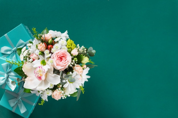 Flower bouquet with gift boxes. wedding gifts