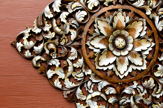 A flower carved in wood
