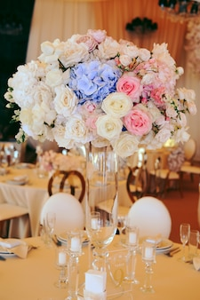 Flower centerpiece bouquet with eustomas and hydrangeas