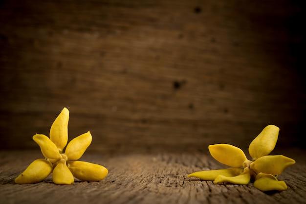 Flower climbing ylang-ylang, climbing ilang-ilang, manorangini, hara-champa kantali champa on wooden