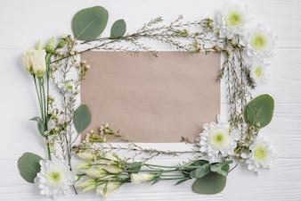 Flower composition around paper