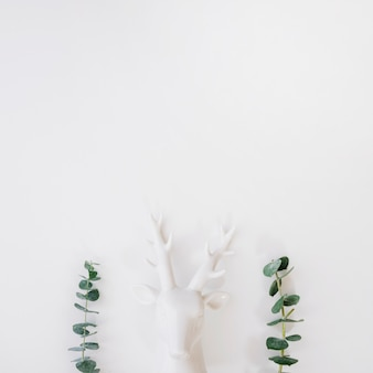 Flower composition with deer statue