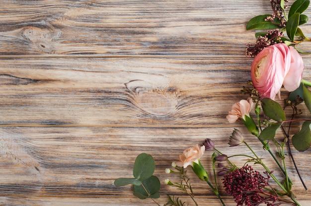 Flower decor on wooden background