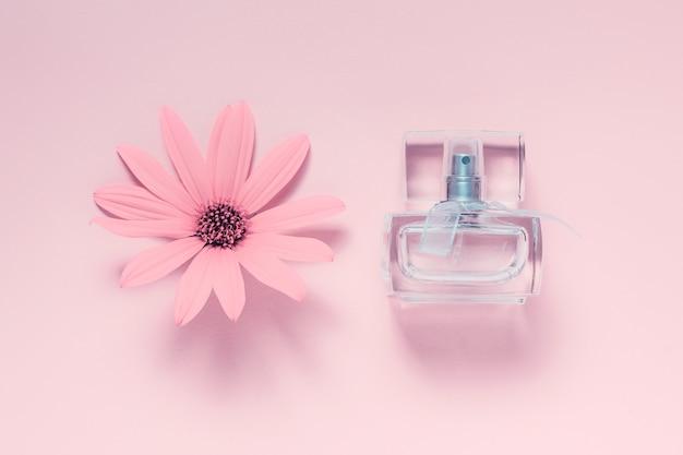 Flower and fragrance bottle on pink
