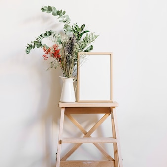 Flower and frame on stool