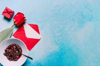 Flower, jam in bowl, gift box and envelope