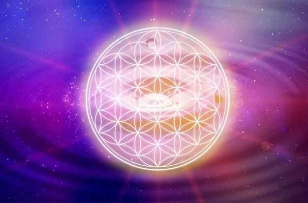 Flower of life symbol in a cosmic field of glowing light