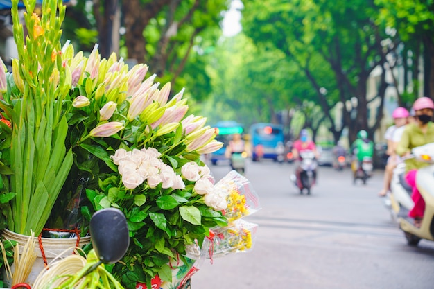 Flower market and bicycle on the road in central hanoi vietnam to consist of lilly.