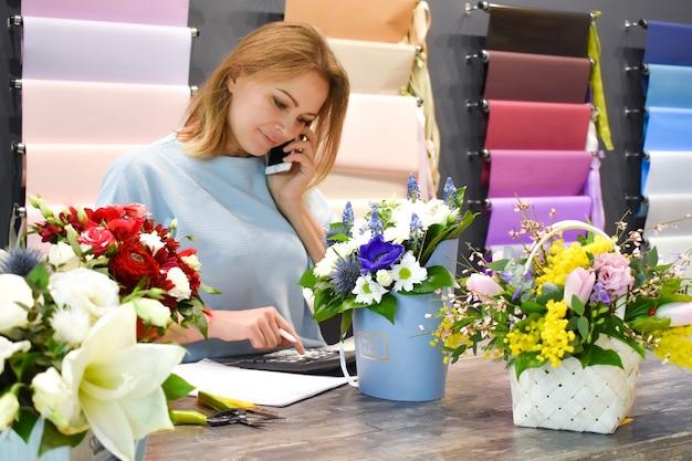 Flower shop. making a decorative flower arrangement.