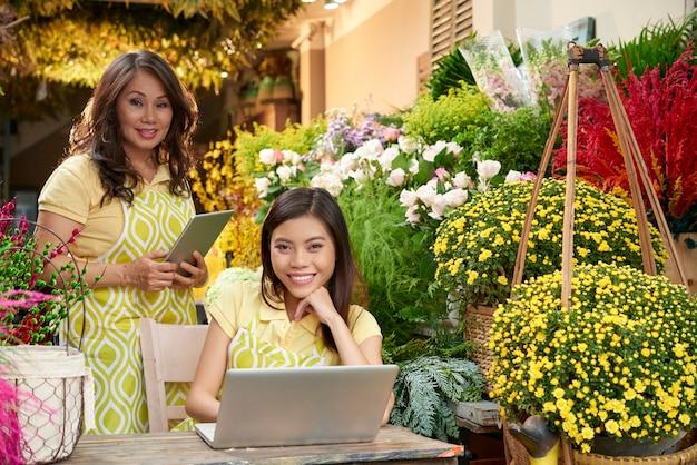 Flower shop manager and florist