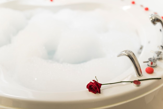 Flower on spa tub with water and foam
