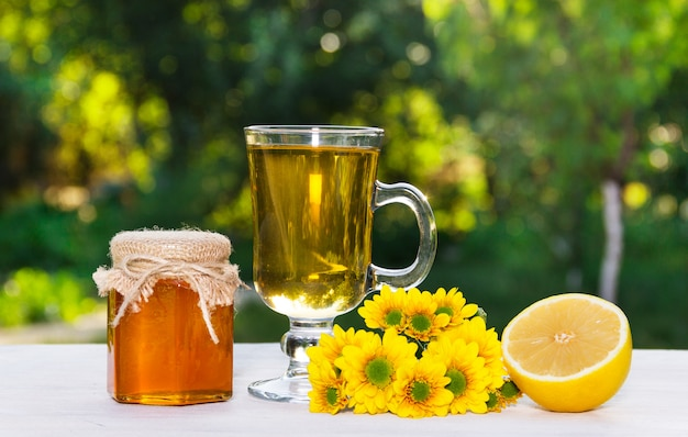 Flower tea, fresh honey and lemon, a natural pharmacy.