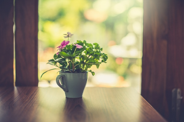 Flower vase on the table at the window