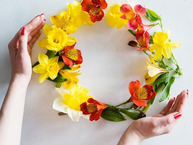 Flower wreath on white background.