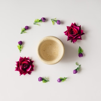 Flowers arranged in circle with coffe mug. flat lay.