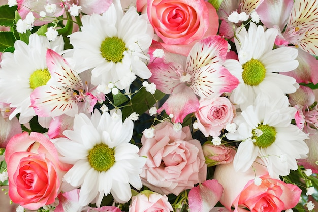 Flowers in bouquet, close-up roses and various, top view, collage