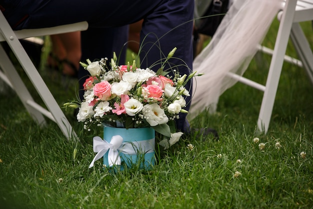 Flowers in box, bouquet or gift of guests for bride and groom after wedding ceremony