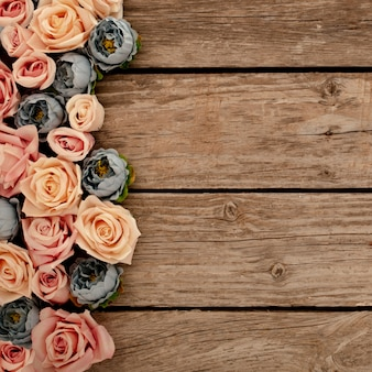 Flowers on brown wooden background