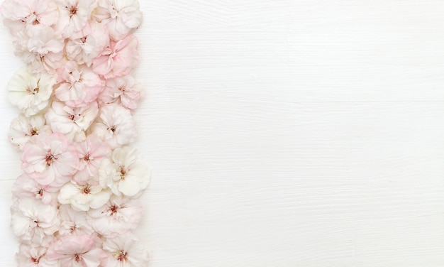 Flowers composition. border made of flowers, flatlay, copy space, top view, desk