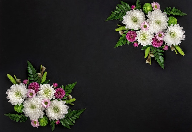 Flowers composition of colorful flowers chrysanthemum isolated on black background. summer wreath of chrysanthemum flowers. flat lay.