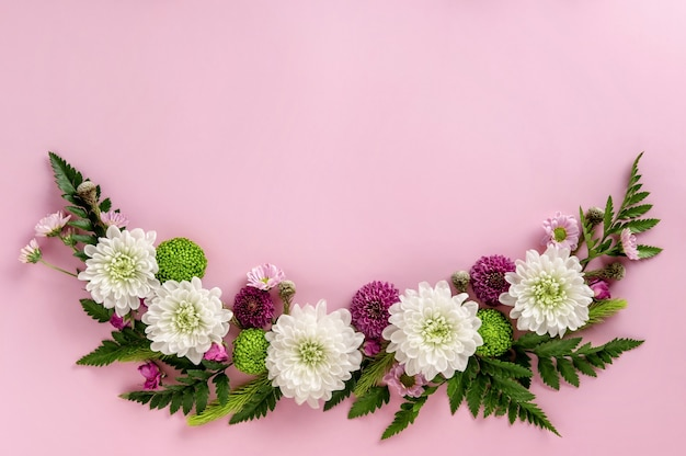 Flowers composition of colorful flowers chrysanthemum isolated on pink background. summer wreath of chrysanthemum flowers. flat lay.