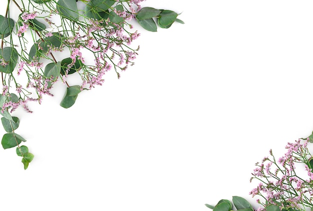 Flowers composition. frame made of pink gypsophila flowers and eucalyptus branches on white background. flat lay, top view, copy space.