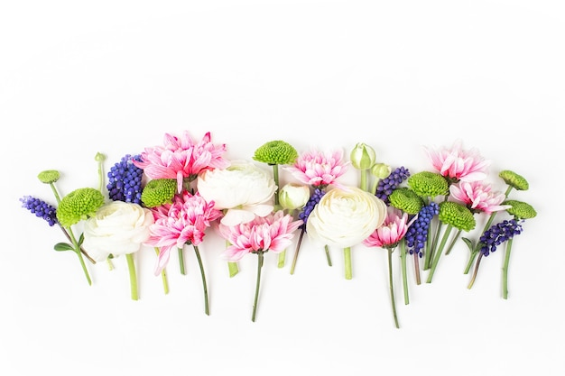 Flowers composition made of ranunculus, chrysanthemum and other flowers on white background. flat lay, top view.