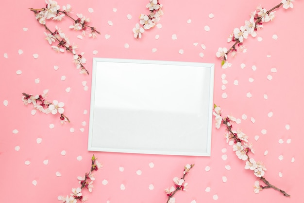 Flowers composition. photo frame, flowers on pinnk background.