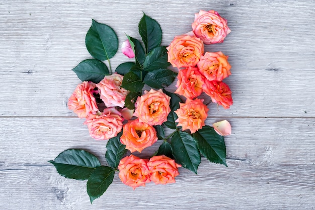 Flowers composition on wooden background. valentines day background.