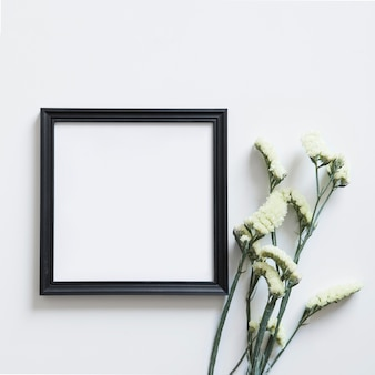 Flowers next to frame for spring
