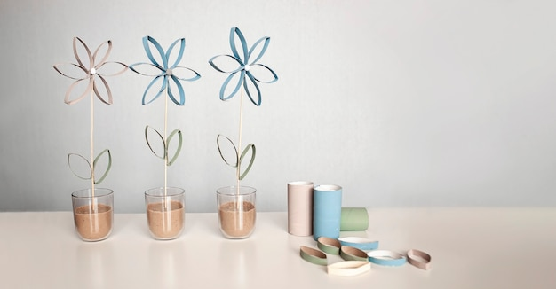 Flowers from toilet roll tube for mother day, zero waste craft for kids, neutral pastel background