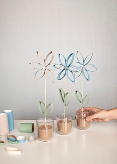 Flowers from toilet roll tube for mother day, zero waste craft for kids, neutral pastel wall