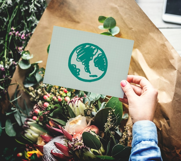 Flowers and a green earth drawing on a card