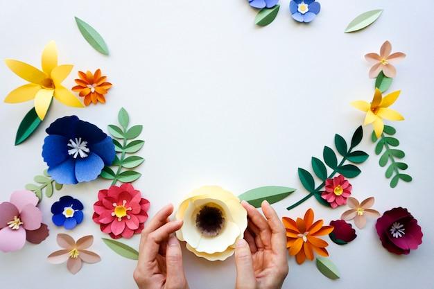 Flowers handmade papercraft art holding hand