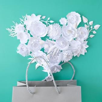 네오 민트 배경에 쇼핑백과 사랑 모양의 꽃. 쇼핑 개념. 판매
