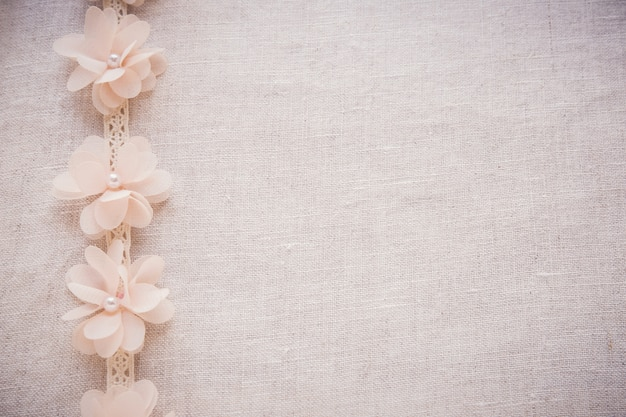 Flowers and lace on linen, copy space toning vintage wedding