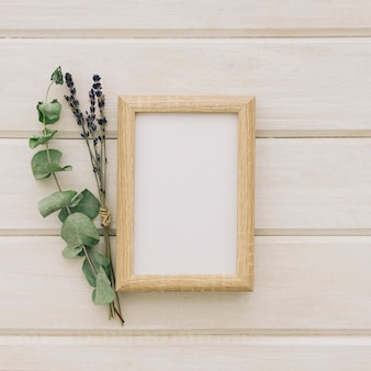 Flowers, leaves and wooden frame